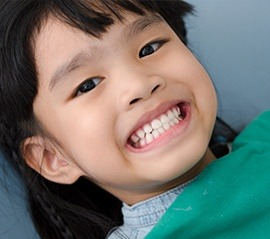 Young child smiling in dental chair