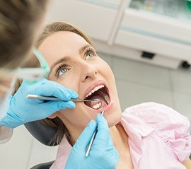 Woman receiving gum disease treatment