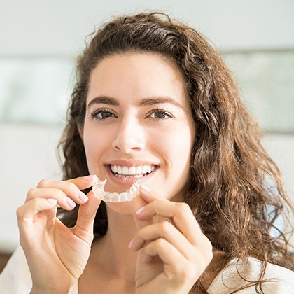 Woman placing her aligner tray