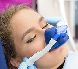 Woman with nitrous oxide nose mask